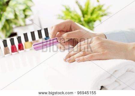 Woman using nailfile