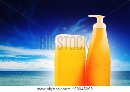 Suntan Lotion Bottles On Seaside Beach