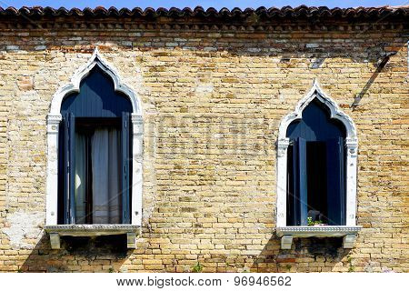 Two Windows And Ancient Brick Wall