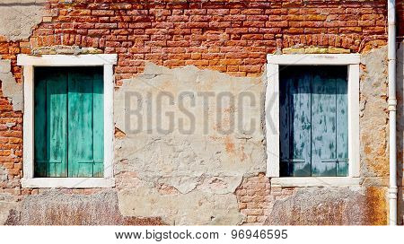 Two Windows And Ancient Decay Brick Wall