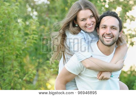 Young Couple Having Fun In The Park In Summer Time
