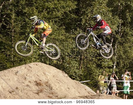 Detail Of Two Bikers On Jumps - Editorial