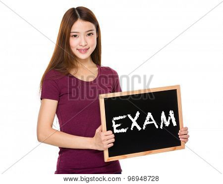 Young student hold with chalkboard showing a word exam