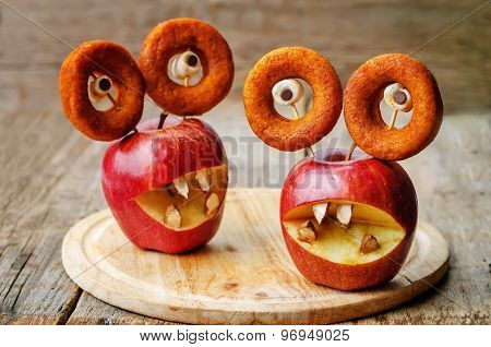 Apples, Marshmallows And Donuts In The Shape Of Monsters For Halloween For Kids