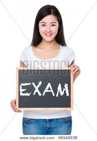 Student with chalkboard showing a word exam
