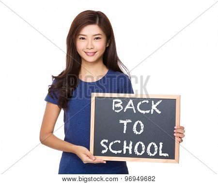 Asian woman with blackboard showing phrase of back to school