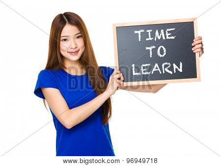 Beautiful asian women asian hold wood blackboard showing phrase of time to learn
