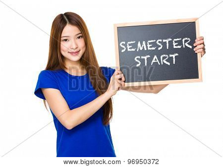 Beautiful asian women asian hold wood blackboard showing phrase of semester start