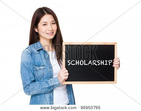 Woman with chalkboard showing a word of scholarship