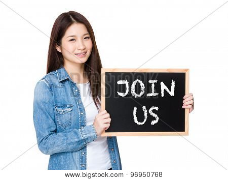 Woman with chalkboard showing phrase of join us