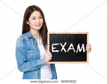 Woman with chalkboard showing a word exam