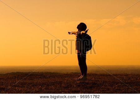 Little hiker gretting the sunset