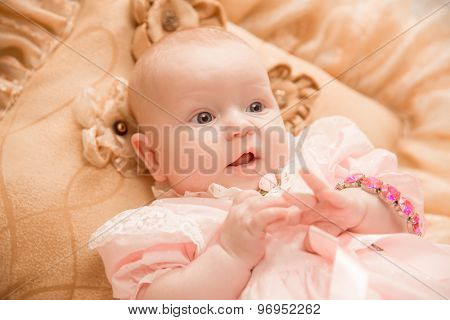 Two-month old baby girl on a light background