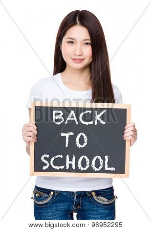 Asian young woman hold with chalkboard showing phrase of back to school