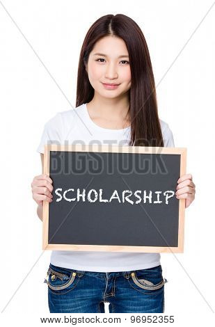 Asian young woman hold with chalkboard showing a word of scholarship
