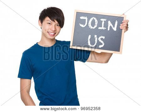 Asian man hold with blackboard and showing a phrases of join us