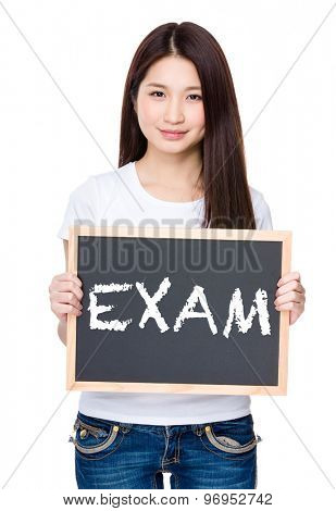 Asian young woman hold with chalkboard showing a word exam