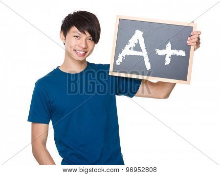 Asian man hold with blackboard and showing A plus mark