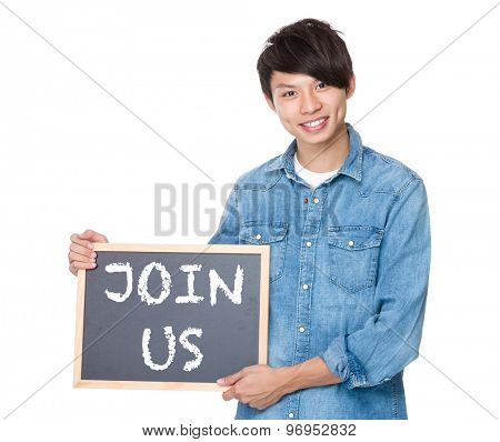 Man hold with blackboard showing a phrases of join us