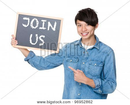 Asian man finger point to chalkboard and showing a phrases of join us