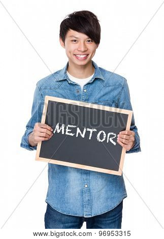 Asian young man with chalkboard showing a word mentor