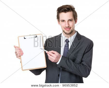 Caucasian young businessman pen point to clipboard