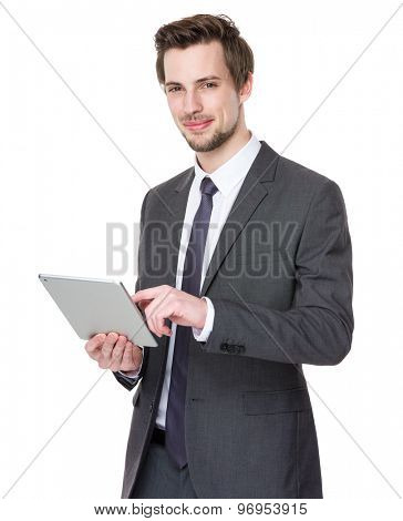 Caucasian young businessman use of tablet