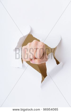 Fist punching through paper