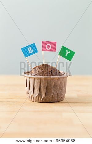 Chocolate muffins with small flag of a word boy