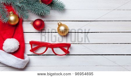 Santas Hat And Christmas Bubbles With Red Glasses