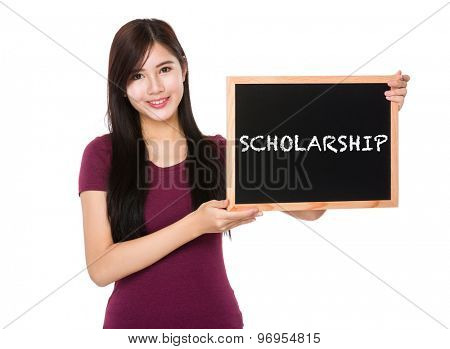 Asian woman hold with the blank chalkboard showing a word scholarship