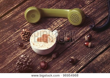 Cup Of Coffee With Heart Shape And Green Handset