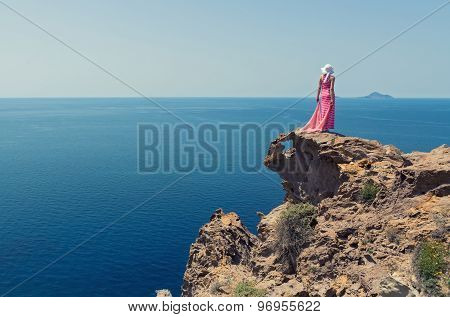 Woman In A Long Summer Dress And Greece, Santorini.