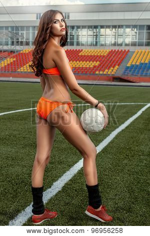 Girl In Bathing Suit Full Growth Standing On Football Field.