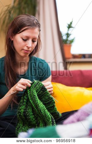 Pretty Knitting Woman On A Couch
