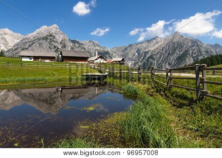 Rural scene in Alps with a lake in the foreground. Austria Walderalm.