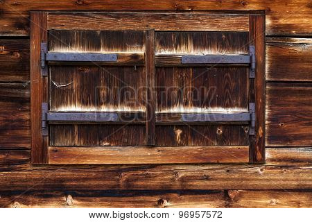Old Wooden Window with Closed Shutters