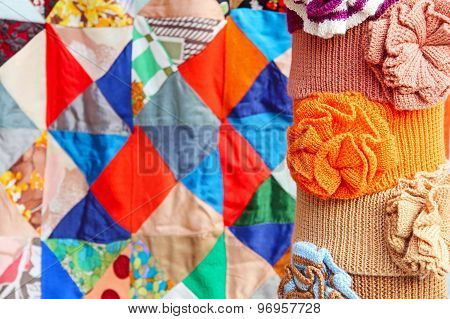 Multicolored Clothing Accessory On Patchwork Quilt Abstract Background.