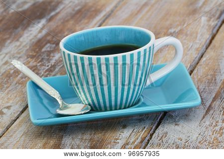 Cup of coffee on rustic wooden surface