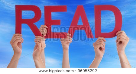 Many People Hands Holding Red Straight Word Read Blue Sky