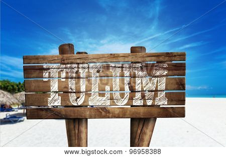 Tulum wooden sign on the beach