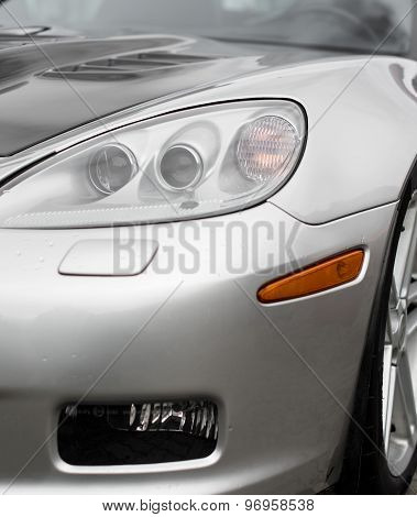 Close-up View Of Silver Sports Car Headlight.