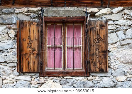 rustic window in a alpine hut
