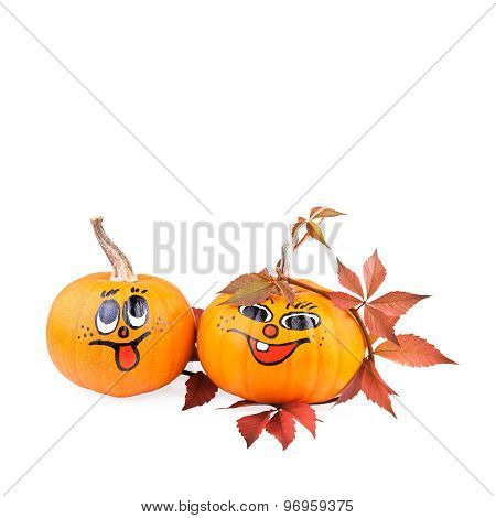 funny painted pumpkin with autumn leaves isolated on white