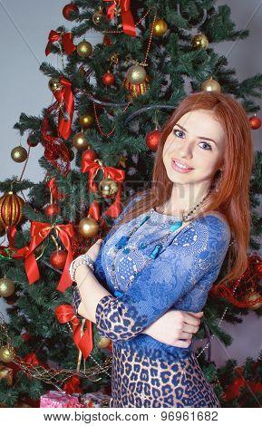Pretty woman near christmas tree