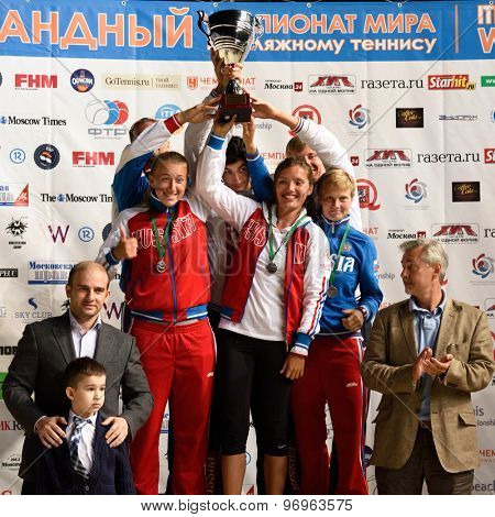 MOSCOW, RUSSIA - JULY 19, 2015: Team Russia with prizes during the Beach Tennis World Team Championship. Italy become world champion, Russia won silver, and Spain got bronze