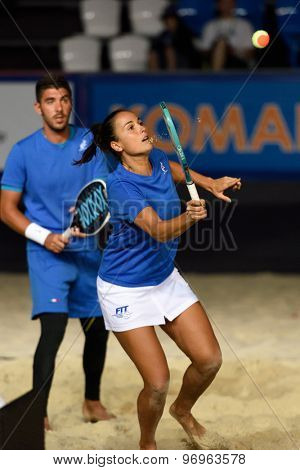 MOSCOW, RUSSIA - JULY 19, 2015: Marco Garavini (left) and Federica Bacchetta of Italy in the final match of the Beach Tennis World Team Championship against Russia. Italy become world champion
