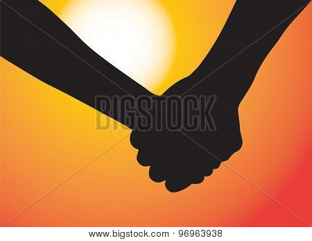 Hands of couple in love. Sunset as background