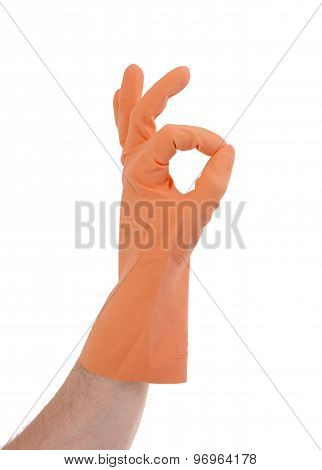 Hand Gesturing With Orange Cleaning Product Glove