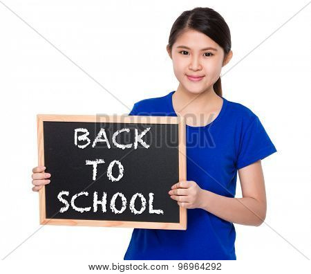 Asian student show with blackboard phrase of back to school